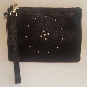 Black wristlet with phone charger